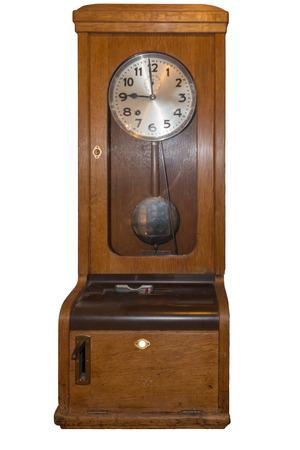 Old Time clock for the recording of working hours. Stock Photo