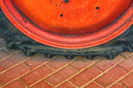 pneu: Closeup of a damaged flat tire of a car or tractor on the road. Stock Photo