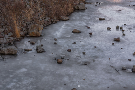 Frozen water surface of a river. The river Ruhr in the city of Essen Kupferdreh. Stock Photo