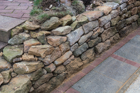 baukunst: Natural stone wall dry laid with sandstone from the city of Rheine. Stock Photo