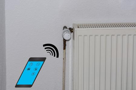 modernize: Smart Home Control concept. Temperature adjustment of heating via smartphone.