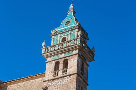 Beautiful view. Tower of the monastery in Valldemossa. Close to the Sierra de Tramuntana.