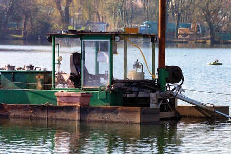 Dredger, Floating excavator when dredging of soil, sand and silt from a river.
