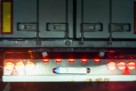 Red taillights on a truck. Truck view from behind with desired blur.