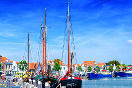 zeeland: Dutch flat bottom boats, sailing boats in a harbor, in Holland Ziereksee. Province of Zeeland, The Netherlands.