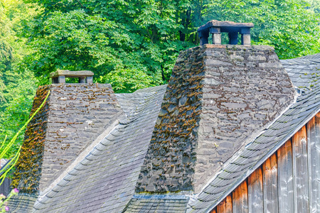Double chimney made of natural stone