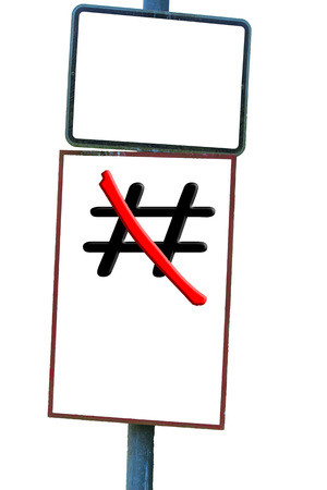 Traffic sign in front of white background the sign Hashtag # red crossed out. Stock Photo