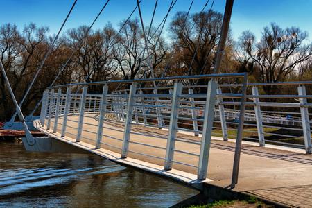 Footbridge modern architecture. Bridge crossing in Dessau Roßlau over the river Mulde. Stock Photo