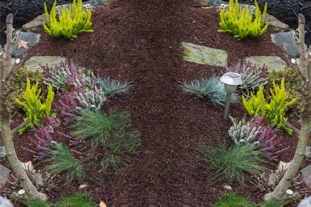 flowerpower: Small freshly made flowerbed in front of a house. Stock Photo