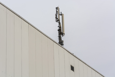 Antenna, telecommunications tower on a roof, wireless telecommunications concept. Stock Photo