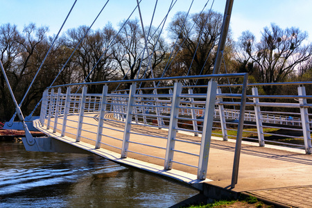 Footbridge modern architecture. Bridge crossing in Dessau Roßlau over the river Mulde. Editorial