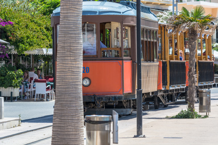 Port De Soller, Spain - June 02, 2016: Vintage train, tram on the beach promenade of the town of Soller in Spain. Opened in 1913, the driving distance is about 5 km long.