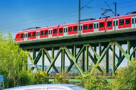 Essen Kettwig, Nrw, Germany - April 28, 2016: Express train crossing the railway bridge in Essen Kettwig on the Ruhr in Germany. By powered express train toward Duesseldorf. Editorial