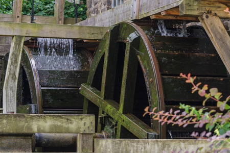 Reconstructed and restored mill wheel of an old water mill in Germany. Stock Photo