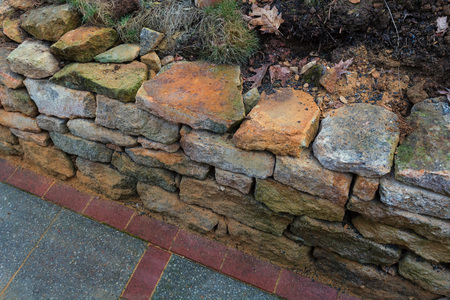 Natural stone wall dry laid with sandstone from the city of Rheine. Stock Photo