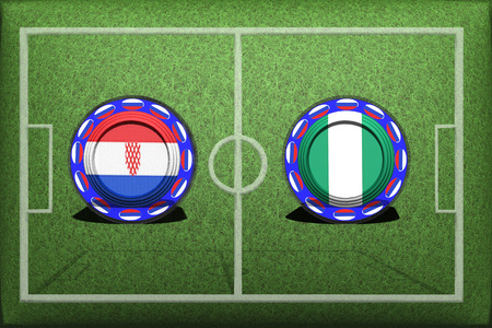 Button with national flags on the green grass. Archivio Fotografico