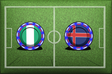 Football, World Cup 2018, Game Group D, Nigeria - Iceland, Friday, June 22, Button with national flags on the green grass. Stock Photo