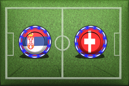 Football, World Cup 2018, game Group E, Serbia - Switzerland, Friday, June 22, Button with national flags on the green grass.