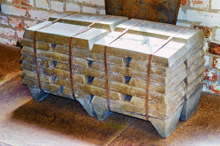 Stack of old raw aluminum ingots in an old foundry