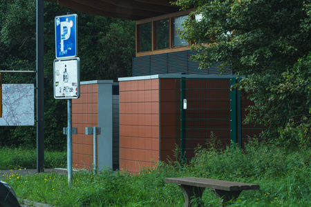 MOTORWAY A 61; GERMANY - AUGUST 13; 2017: View from a parking lot to a public toilet on the A 61. Redakční