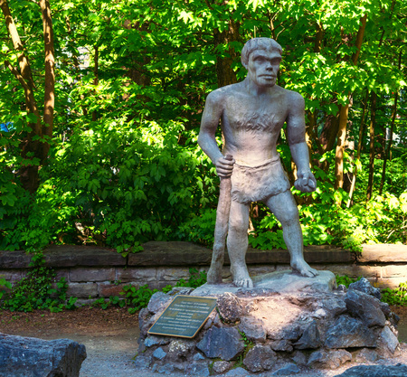 METTMANN, NRW, Germany - MAY 15, 2017: Statue of a Neanderthal man in front of the Neanderthal Museum in Mettmann near Düsseldorf