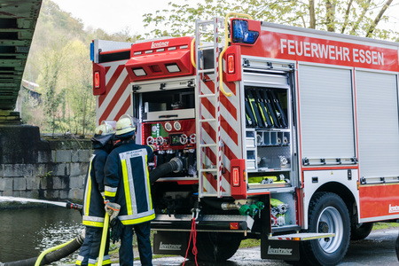 ESSEN KETTWIG, NRW, DEUTSCHLAND - APRIL 28, 2016: Fire fighter trainer use in Essen Kettwig, Germany. Firefighters in Uniform during training.