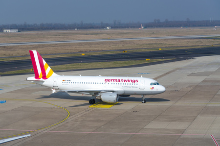 DUESSELDORF, NRW, GERMANY - MARCH 18, 2015: Up, Airplane Dusseldorf. View of the tarmac. Large passenger airplane at the gate.