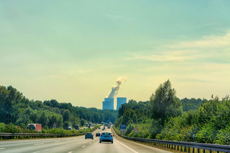 UNNA, GERMANY - AUGUST 2, 2017: Traffic on the A2 motorway and Scholven coal power station, Germany, North Rhine-Westphalia. Editorial