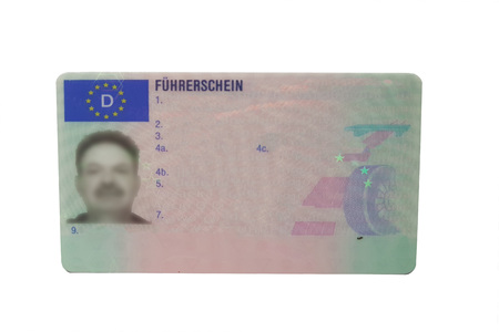 Driving license identity card isolated. Plastic ticket of flat driver license in Germany Фото со стока
