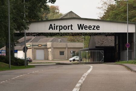 WEEZE, NRW, GERMANY - SEPTEMBER 10, 2018: Military outward access to Weeze Airport with old barracks buildings
