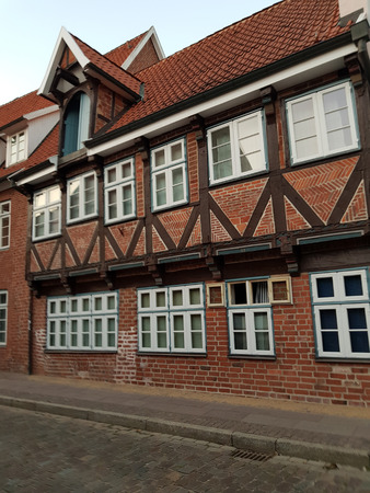 Half-timbered red brick houses near the river on the old harbor Lueneburg, Germany