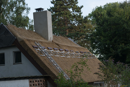 Professional execution of a repairs to a thatched roof