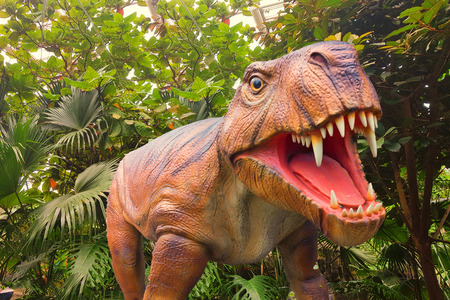 Tyrannosaurus with open mouth in the background a jungle