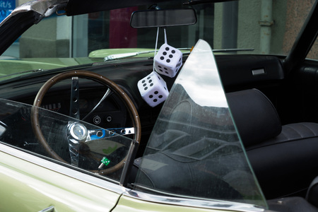 HEILIGENHAUS, NRW, GERMANY - SEPTEMBER 10, 2017: Fuzzy Dice on the rearview mirror of a vintage American car Editorial