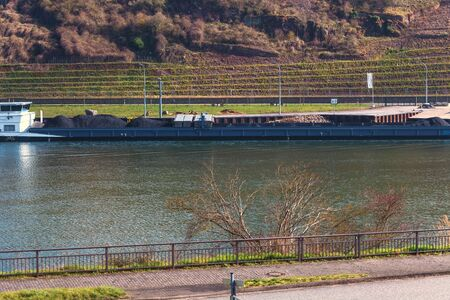 Domestic transport by ship across the Moselle in Germany on a bright summer day.
