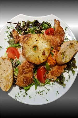 Crunchy low carb schnitzel with pineapple Stock Photo