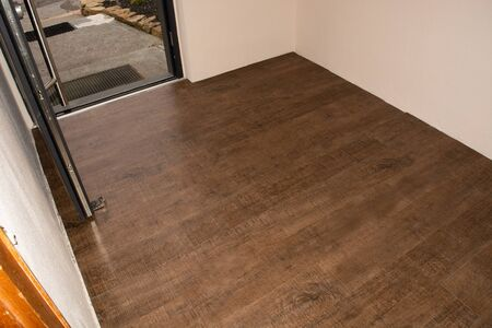 Laminate flooring. Threaded panel of a laminate floor on a thermally insulated floor. Electric underfloor heating, radiant heating, infrared carbon heating foil for the floor