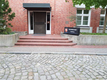 LUENBURG, LOWER SAXONY, GERMANY - JULY 27, 2017: Entrance to the building of the public prosecutor's office in the city Lueneburg in Germany