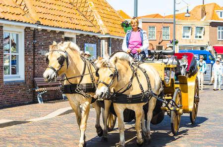 ZIERIKZEE, ZEELAND, NETHERLANDS - JUNE 15, 2015: Carriage ride through the beautiful old port town of Zierikzee, Zeeland in the Netherlands.