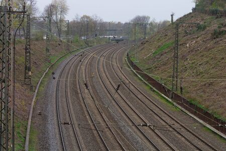 View from a bridge on railroad tracks