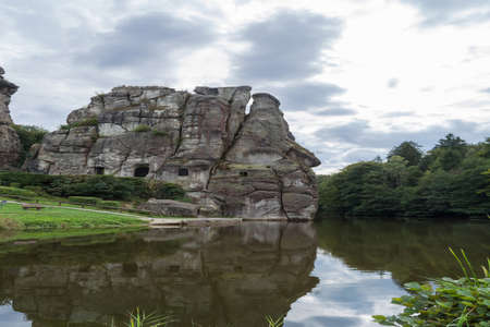 Beautiful rocky landscape with unique Mystic rock formation in a dramatic sky.