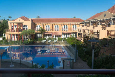 View of holiday apartment complex with swimming pool in Meloneras, Gran Canaria in Spain.