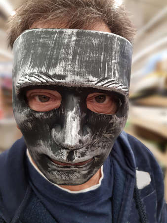 Man with a scary black face mask Standard-Bild