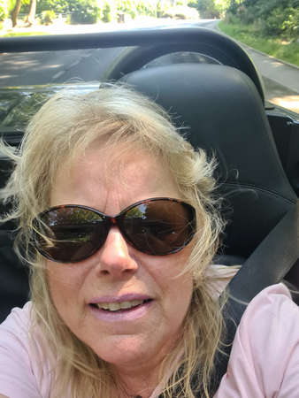 Woman with her boyfriend driving convertible Reklamní fotografie