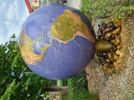 Drinking and washing water taps or fountains with the earth globe on top.