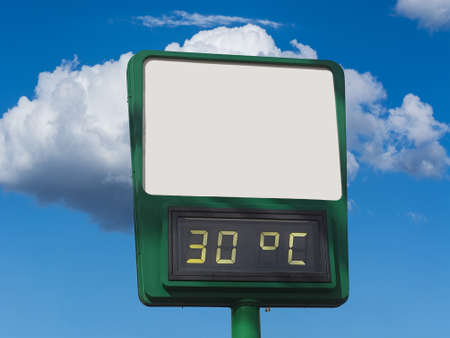 Electronic large thermometer on the building, indicating a high summer air temperature 30 degrees Celsius. Summer hot weather, heat