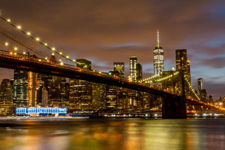 View of Manhattan skyline and Brookyn bridge from Brooklyn side after sunset , New york city , United States of America - September 3 , 2018