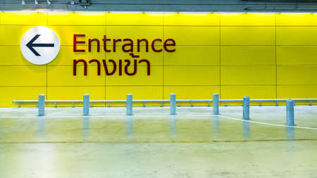 entrance sign: Entrance Sign in English and Thai.