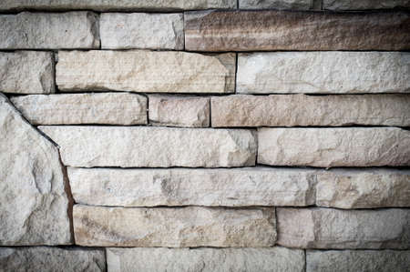 Stacked stone wall, background and texture. photo