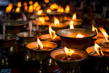 Chinese people worship with oil lamps. photo